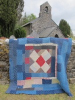 patchwork_quilt_on_church_wall